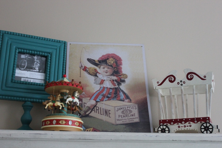 Turquoise frame from Target and vintage finds. The carousel is musical and I had it from my childhood!