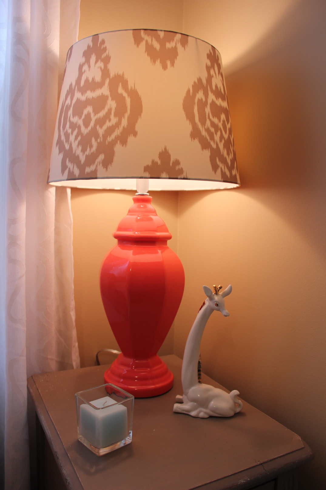 I got the tangerine lamp bases and Ikat shades from Target, mix and match. The giraffe was a vintage find and I love his mid century modern look. He is porcelain so he will be put away when baby starts walking.