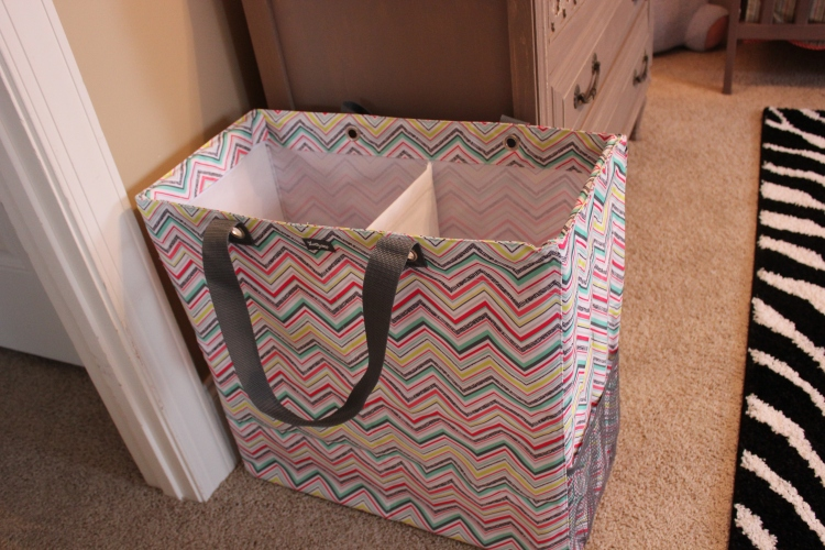 I got this two sided hamper from a 31 party. The center divider is removable and completely folds up. This will be so nice to carry downstairs to the laundry room. It also matches my diaper bag