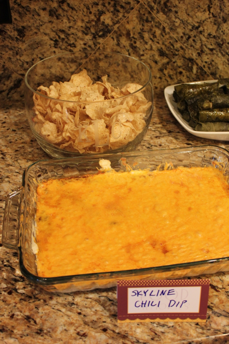 My husband as you know is from Cincinnati so he has a long standing love affair with Skyline Chili. He was so excited to find the chili in the freezer section here in Charlotte. The recipe for the dip is on the box: 1 package cream cheese, 1/4 cup diced onions and 12 oz (or more if you're Chris) of shredded cheddar cheese.Everything is layered in that order and bake at 350 for 10-15 minutes or you could nuke it in the micro for 2 minutes.